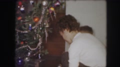 1958: three people decorating a christmas tree in a house in the living room Stock Footage