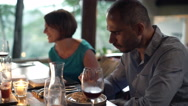 Young happy friends during dinner at restaurant, 4K Stock Footage