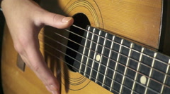 Girl playing on acoustic guitar, slow motion 500 fps Stock Footage