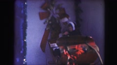 1958: a child on santa's lap in a christmas themed sleigh AMES, IOWA Stock Footage