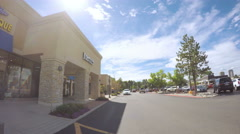 POV point of view - Driving through  shopping center. Stock Footage