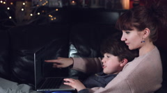 4k Authentic Shot of a Child with his Mum Playing on Laptop Stock Footage