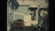 1958: a woman is seen coming out of a house AMES, IOWA Stock Footage
