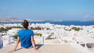 Young boy on street with amazing view on Mykonos, Greece. Beautiful famous Stock Footage