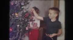 1958: a christmas tree is seen with people around AMES, IOWA Stock Footage