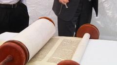 Hand of boy reading the Jewish Torah at Bar Mitzvah Torah reading 5 SEPTEMBER Stock Footage