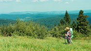 Little hiker girl using map. Tourist child with travel backpack standing Stock Footage