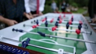 Closeup of people playing foosball. Stock Footage