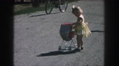 1958: a small girl is seen happy and walking AMES, IOWA Stock Footage