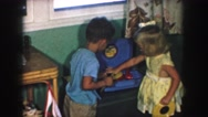 1958: a boy and a girl operating the cd player kept in the room AMES, IOWA Stock Footage