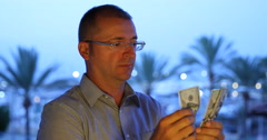 Man Counting Money American Dollars Banknotes Bills Tropical Island Palm Trees Stock Footage