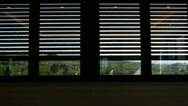Rolling shutter closing on a window appearing at a green countryside. Stock Footage