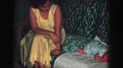 1958: a mother with a small child is seen AMES, IOWA Stock Footage