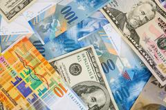USD and CHF banknotes as background Stock Photos