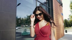 Pretty young woman walking in the city with her shopping bags. Slow motion Stock Footage