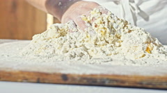 Hands of little baker mixed eggs with flour to make dough for bread Stock Footage