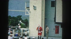1958: a man dressed as santa claus talking to the public in a show AMES, IOWA Arkistovideo