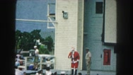 1958: a man dressed as santa claus talking to the public in a show AMES, IOWA Stock Footage