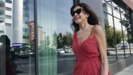 Happy young woman walking on the street and looking around on the city Stock Footage
