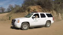 Park Ranger Driving on Dirt Road Stock Footage