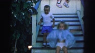 1958: gorgeous little girl and his brother getting fun in a simple way AMES Stock Footage