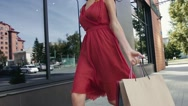 Smiling young lady walking happily down the street Stock Footage