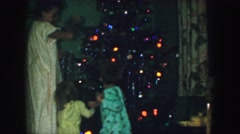 1958: mother and children decorating vintage christmas tree in home AMES, IOWA Stock Footage