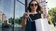 Cheerful woman holding her shopping bags. Slow motion Stock Footage