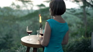 Young woman drinking wine and admire jungle view in bar in the evening, 4K Stock Footage