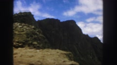 1958: driving fast on a hilly terrain with a scenic view of the world below Stock Footage