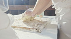 Making dough by little boy hands at bakery Stock Footage