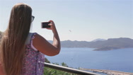 Pretty woman make a photo of landscape using smartphone mobile cell phone camera Stock Footage
