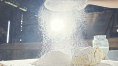 In slow motion boy sows flour Stock Footage