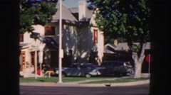 1958: cars parked in front of a house in a beautiful middle class neighborhood Stock Footage