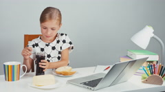Portrait school girl 7-8 years using knife making sandwich with butter and jam Stock Footage