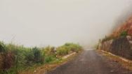 Camera Moves along Misty Mountain Asphalt Road Stock Footage