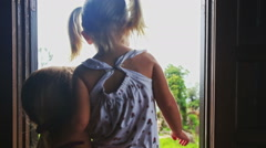 Mother Lifts in Arms Blond Girl Shows Foggy Hill out of Window Stock Footage