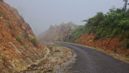Camera Moves along Misty Mountain Asphalt Road Stock Footage