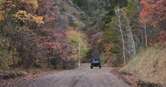 Mountain road Autumn colors recreation vehicle towards fast DCI 4K Stock Footage