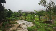 Yersin House Back Site against White Thick Mist in Mountains Stock Footage