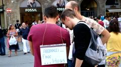 Free hugs boy. Piazza della Signoria, Florence Italy Stock Footage