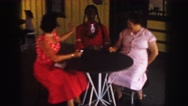1958: two women and a dummy sitting a a table. COLORADO Stock Footage