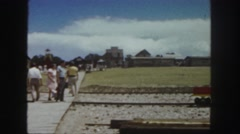 1958: flood debris and wreckage laying on the beach by the boardwalk COLORADO Stock Footage