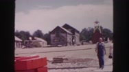 1958: people are walking down the sidewalk in a small town. COLORADO Stock Footage
