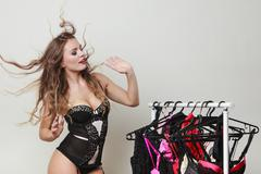 Expressive sexy lady with collection of lingerie. Stock Photos