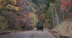 Mountain road Autumn colors recreation vehicle away fast DCI 4K Stock Footage
