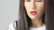 Close up of woman face blowing fume on camera. Slowly Stock Footage
