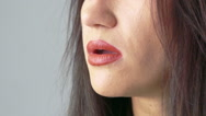 Profile of woman face blowing fume on beige background. Slowly Stock Footage