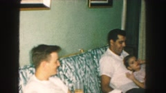 1958: family sitting in the living room on the eve of xmas AMES, IOWA Stock Footage