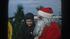 1958: santa claus giving advice to children on the eve of x'mas AMES, IOWA Stock Footage